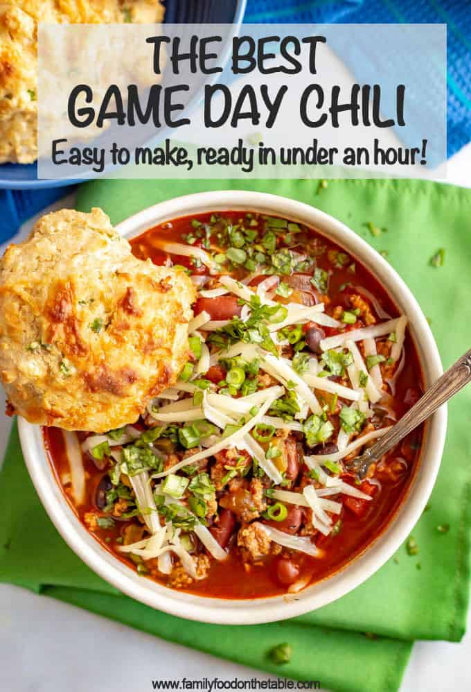 The best game day chili is loaded with ground turkey and beef, two kinds of beans, tomatoes and the perfect blend of spices for an easy, but rich and satisfying chili. Everyone will be going back for seconds! #chili #gamedayeats #healthychili #easychili