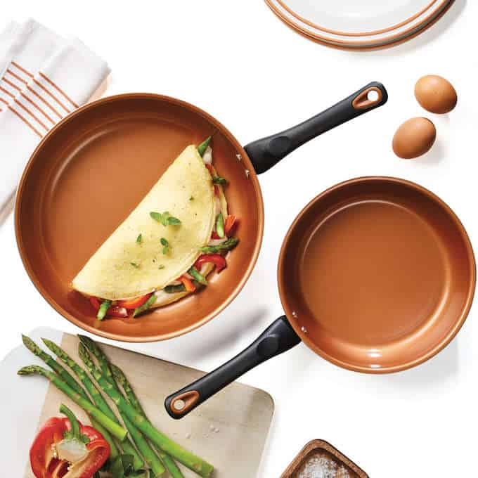 Farberware copper pans with an omelet in one pan