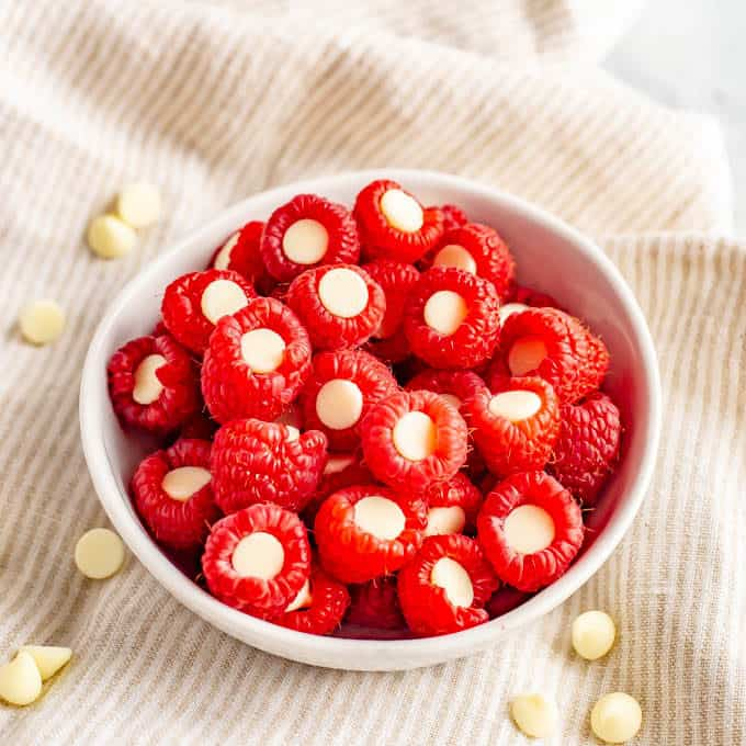 Raspberries stuffed with white chocolate chips for an easy, fun and healthy Valentine's Day snack