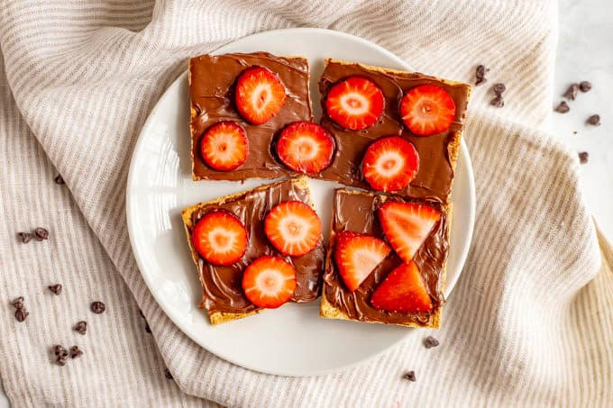 Graham crackers with Nutella and sliced strawberries for an easy, fun Valentine's Day snack for kids