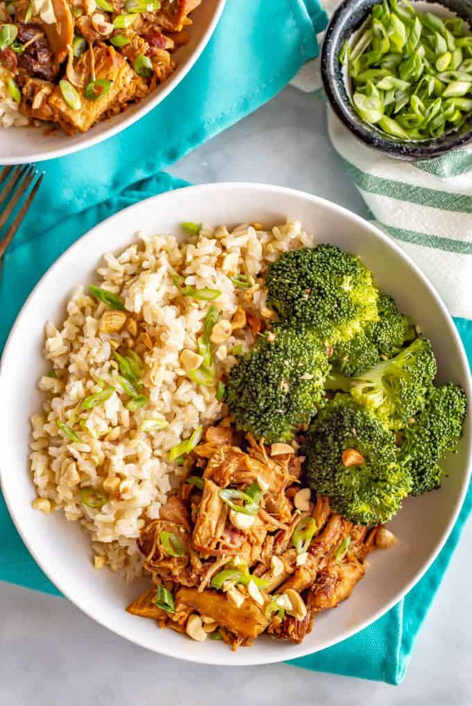 Honey garlic chicken rice bowls with brown rice and steamed broccoli are simple and full of flavor. Drizzle extra sauce over your entire plate and be ready to dig in! #chickendinner #ricebowl #grainbowl #healthychickenrecipes #mealprep