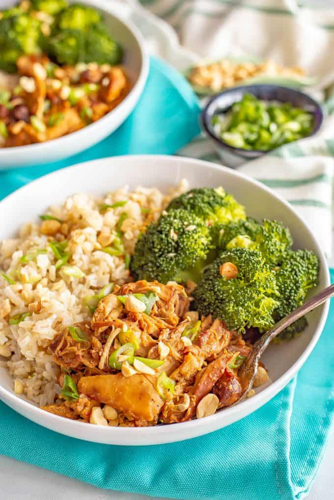 Honey garlic chicken served in a bowl with rice and broccoli