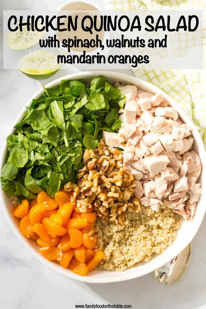 Quinoa chicken spinach salad with mandarin oranges, walnuts and a honey-lime vinaigrette -- a flavorful main dish salad that's ready in just 20 minutes! #chickensalad #quinoasalad #quinoarecipes #healthyrecipes #lunchsalad