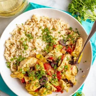Slow cooker Mediterranean chicken is quick and easy to prep and bursting with bright, healthy flavors. This meal is loaded with tomatoes, artichokes and olives and goes great with rice or couscous. #slowcooker #chickendinner #easychickenrecipes #mediterraneanchicken