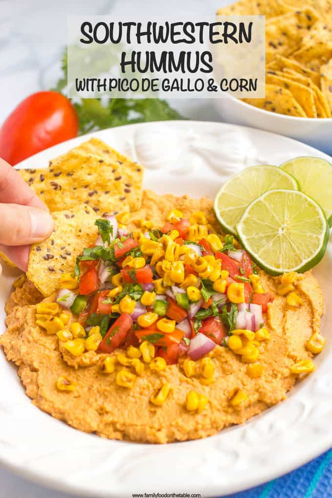Southwestern hummus dip is topped with an easy, fresh pico de gallo and charred corn for a fun and tasty appetizer! #hummus #salsa #appetizer #gamedayeats #healthysnacks