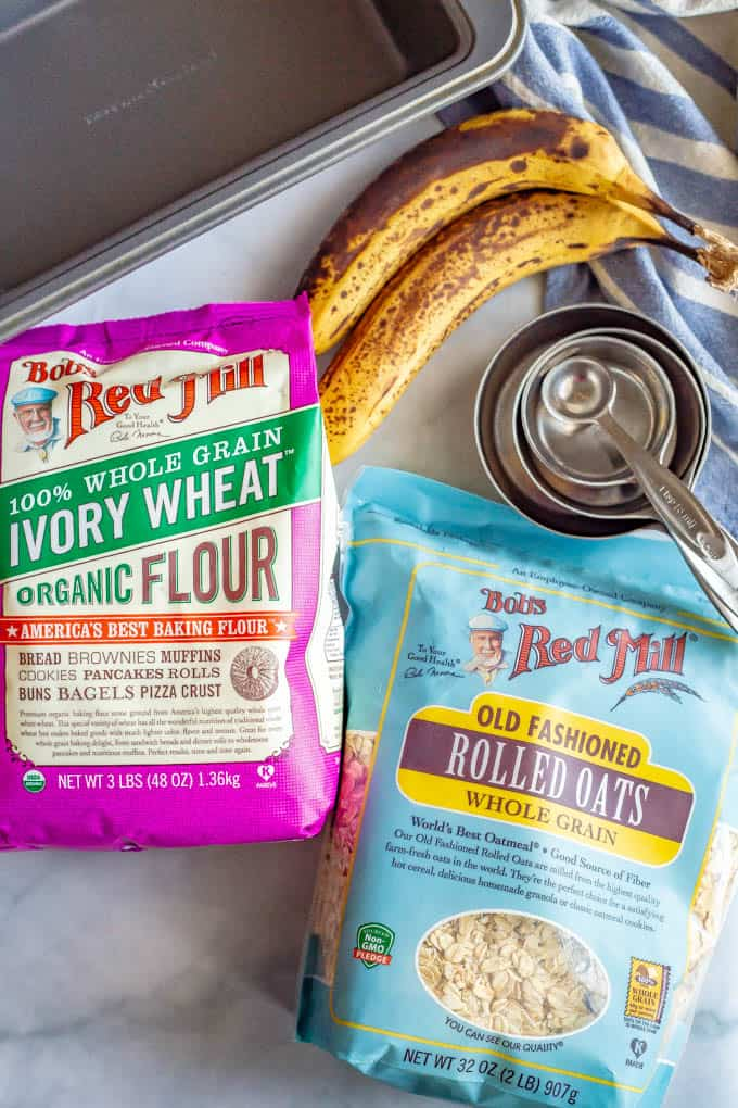 Whole grain flour and oats with banana and baking ingredients