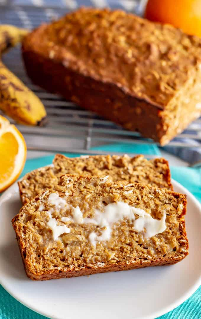 Whole grain banana applesauce bread is naturally sweetened and made without butter or oil. This easy, light and wholesome bread is perfect for a healthy breakfast or snack. #bananabread #healthybaking #healthybreakfast