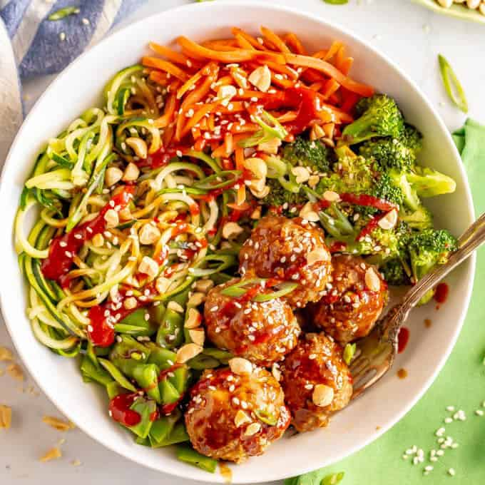 Asian turkey meatballs and veggie bowls are loaded with colorful veggies and finished with a delicious hoisin-based sauce that will have you diving in for more! #veggiebowls #meatballs #mealpreprecipes