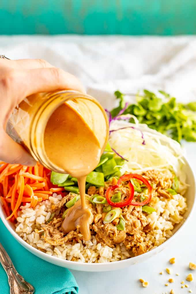 Peanut chicken rice and cabbage bowls are a crunchy, colorful and delicious way to serve peanut chicken. They're drizzled with an easy but irresistible peanut dressing. #peanutchicken #ricebowls #veggiebowls #mealprep