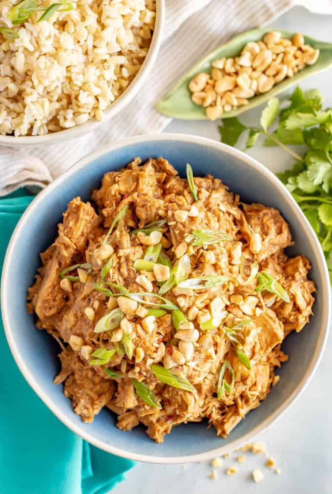 Slow cooker peanut chicken is quick and easy to prep, just 7 ingredients and comes out coated in a delicious peanut sauce! Great for meal prepping or an easy weeknight dinner! #slowcookerrecipes #slowcookerchicken #peanutchicken #mealprep #easydinnerideas