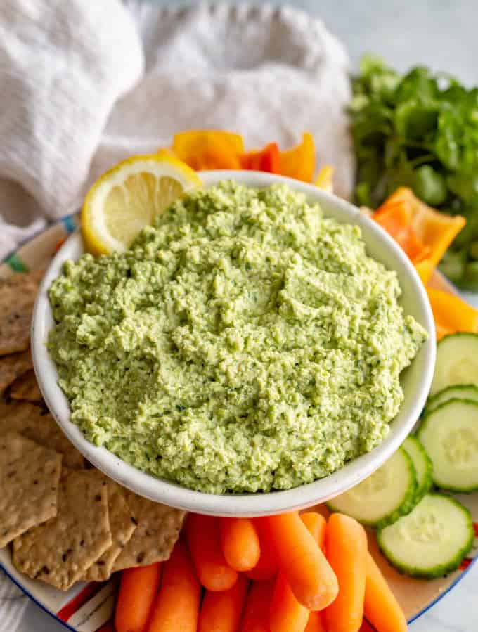 Spicy edamame dip is a super quick and easy appetizer with bright, fresh flavors and a hint of heat. It's perfect for serving with crackers and veggies! #edamame #easyappetizer #healthyappetizers #stpatricksday