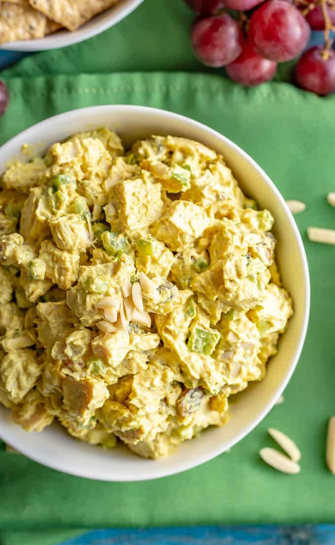 Healthy curry chicken salad with Greek yogurt and almonds served in a white bowl