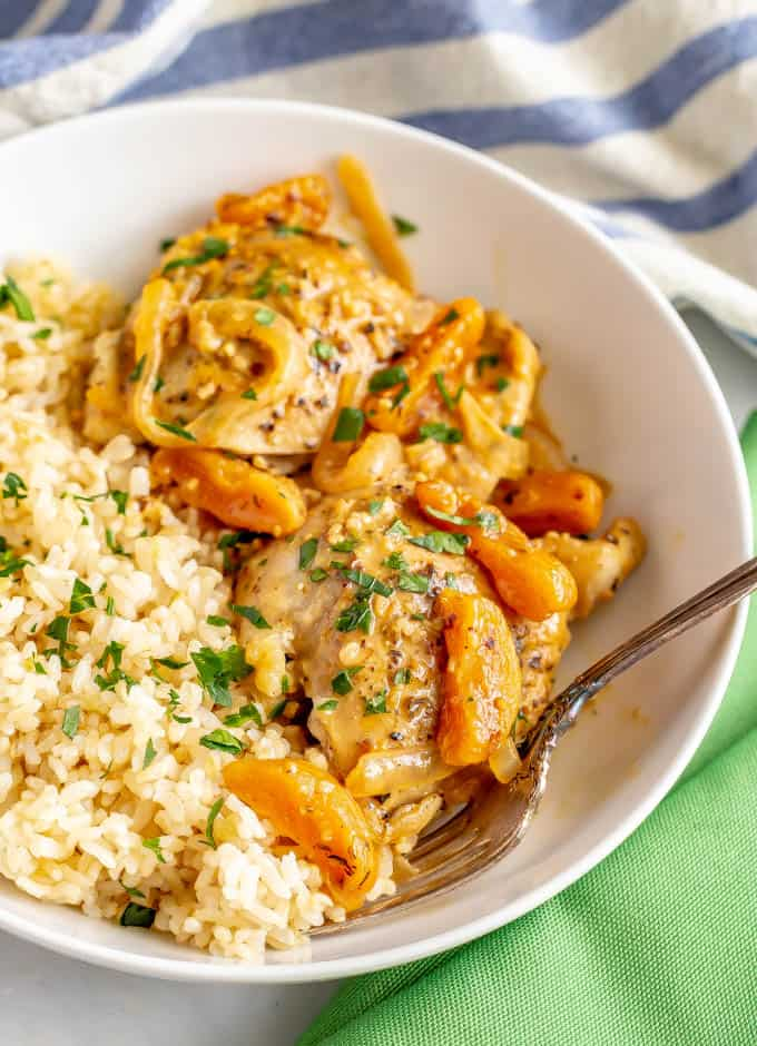 Skillet apricot chicken is an easy, 30-minute recipe using chicken thighs and dried apricots for a delicious dinner with big, fresh flavors and a creamy, dreamy sauce. #easychickenrecipes #chickendinner #apricots #chickenthighs
