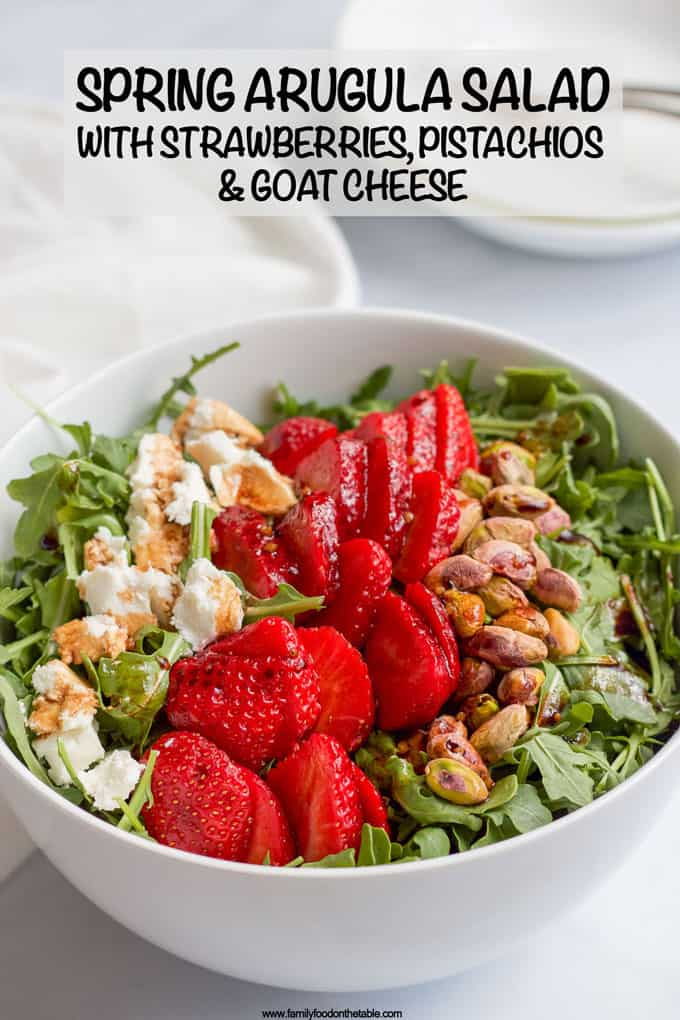 This baby arugula salad with strawberries, pistachios, goat cheese and an easy homemade balsamic vinaigrette is perfect for a fresh and healthy spring or summer salad! #arugula #saladrecipes #healthysalads