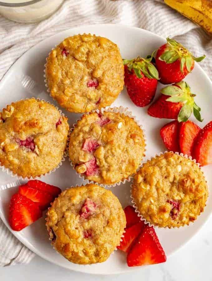 Healthy strawberry banana muffins are whole grain and naturally sweetened and perfect for a fruit-filled breakfast, lunch or snack time treat! Kids love them! #muffins #kidfood #strawberries #ripebananas #healthykids