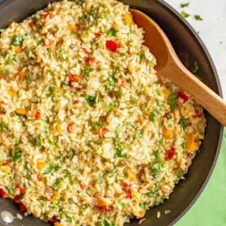 Confetti rice is a fun mix of fluffy brown rice and colorful bell peppers that's great as a side dish or for tacos or grain bowls. Add your favorite toppings and enjoy! #rice #sidedish #easyrecipe #healthyrecipes