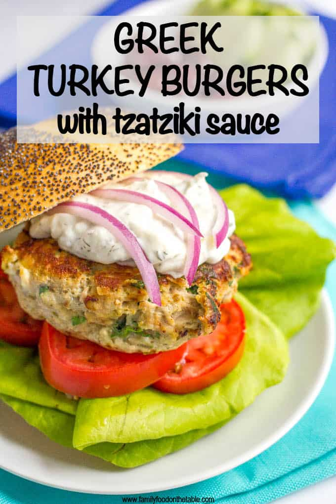 Greek turkey burgers with tzatziki sauce are loaded with spinach, red onion and feta cheese for a delicious but easy taste of Greece! #turkeyburger #burgers #summerrecipes