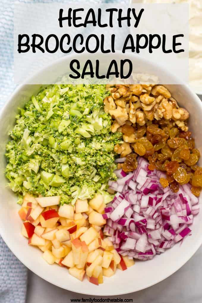 Healthy broccoli salad is mixed with apples, walnuts, raisins and a cool, creamy sweet dressing for a delicious side salad that's perfect for cookouts! #broccoli #summersalads #summerrecipes #potlucks