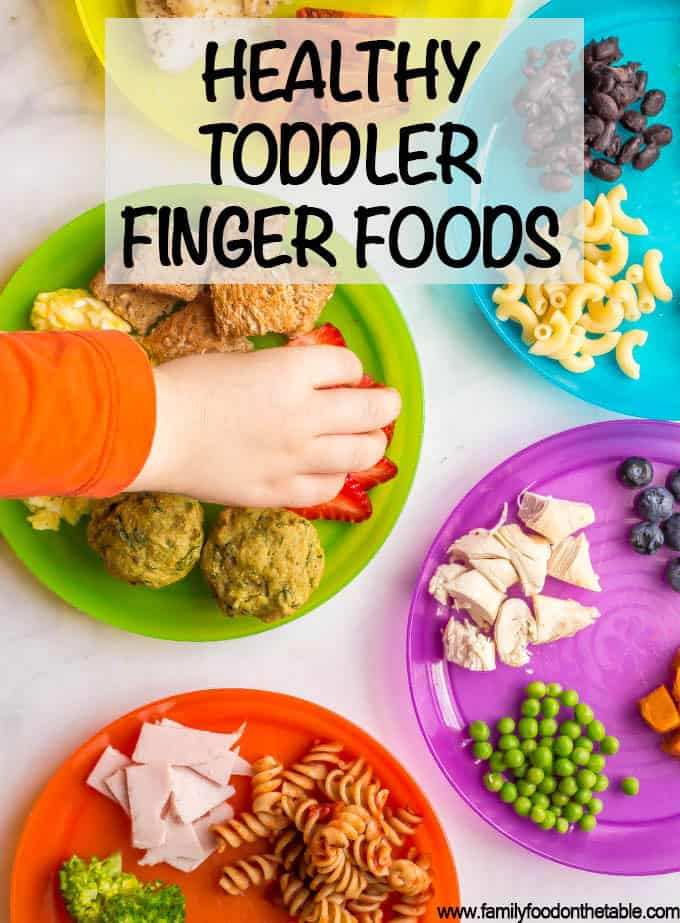 A collection of healthy toddler finger food ideas including fruits, veggies, proteins, grains and dairy choices that are safe and appropriate for older babies and toddlers to eat at mealtimes. Also a free printable so you don't get stuck in a rut with serving the same few foods! #toddlers #fingerfoods #kidsfood