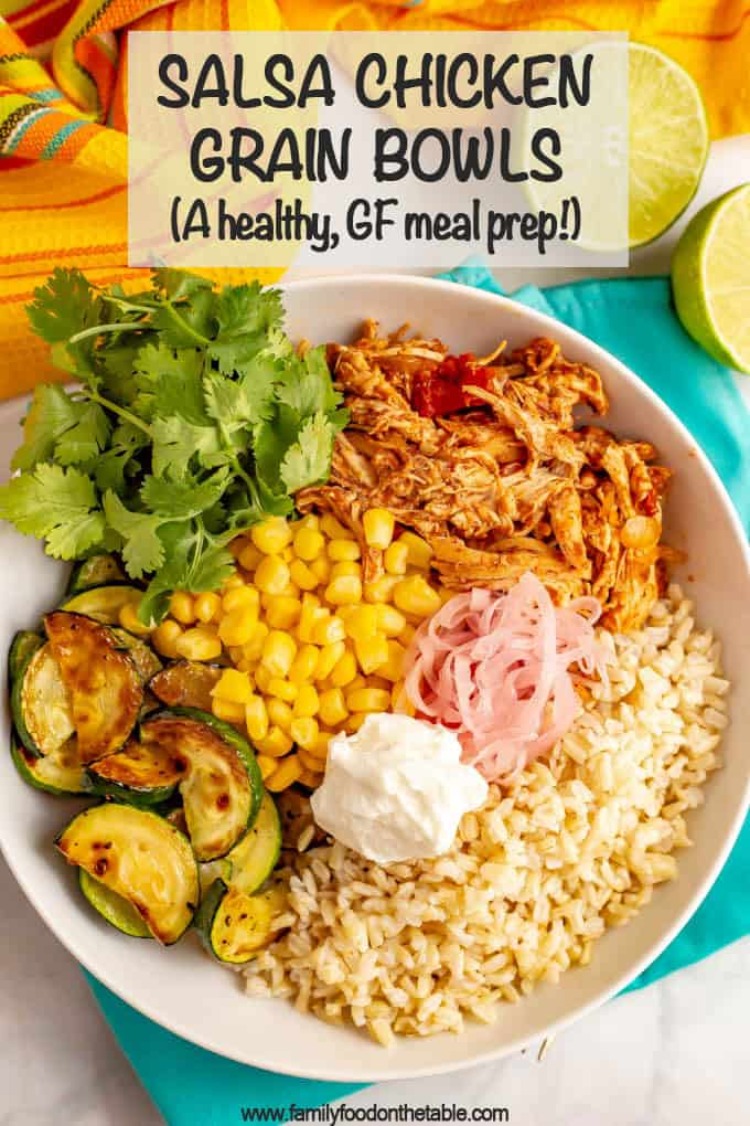 Salsa chicken grain bowls are full of juicy, tender chicken, fluffy grains, fresh and sautéed veggies and tons of toppings. Great for meal prep or an easy dinner! #chicken #grainbowls #mealprep #healthyeating