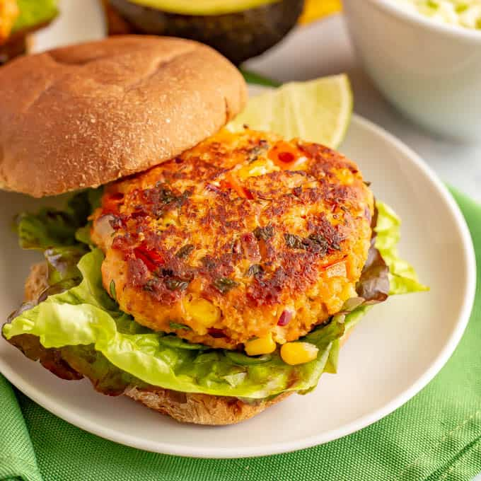 Close up of southwestern salmon burger served plain on a bun with lettuce