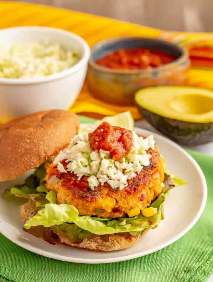 Southwest salmon burgers are full of fun mix-ins and tasty seasonings plus have lots of great topping options too! Great for a delicious, healthy burger at lunch or dinner. #salmon #seafood #burgers