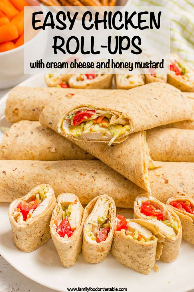 Chicken roll up wraps with tomatoes and veggies cut in small and big pieces