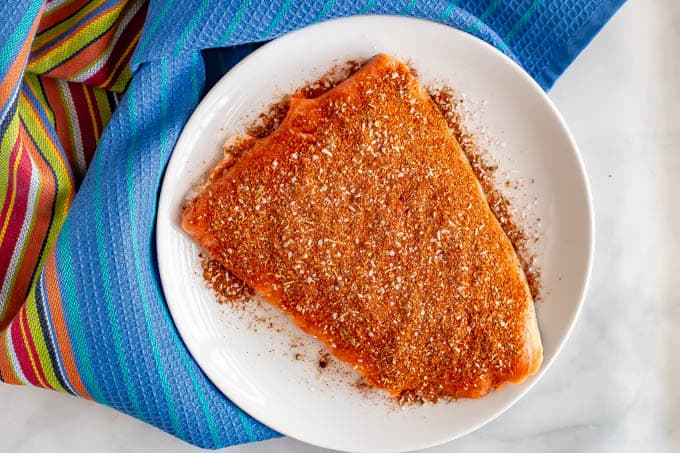 Large piece of salmon sprinkled with southwestern seasoning