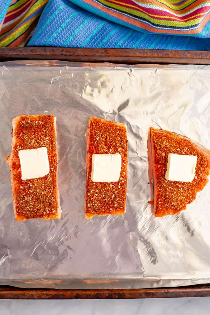 Salmon filets topped with southwest seasoning and a pat of butter before being roasted