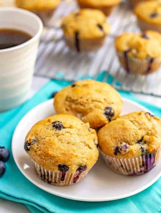 Healthy blueberry muffins and so light and fluffy and bursting with juicy blueberries! These muffins are whole wheat, naturally sweetened and perfect for a yummy, healthy breakfast! #breakfast #muffins #blueberries #blueberrymuffins