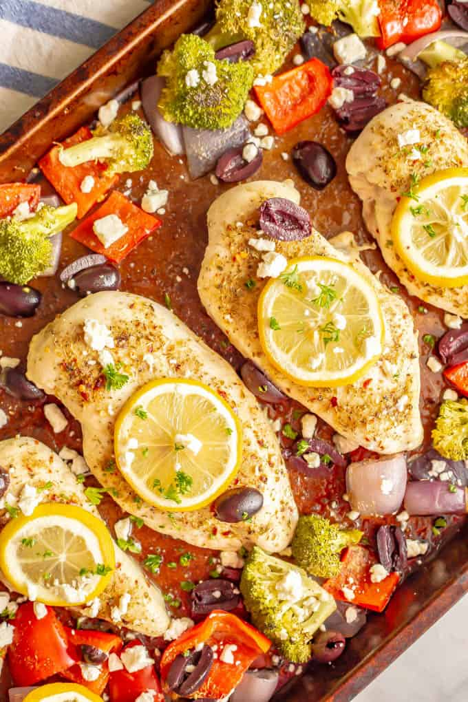 Sheet pan Mediterranean chicken and veggies are seasoned with a yummy spice mixture and roasted together for an easy, healthy, hands-off dinner. #mediterraneanfood #chickenrecipes #chickendinner #sheetpandinner #dinnerideas