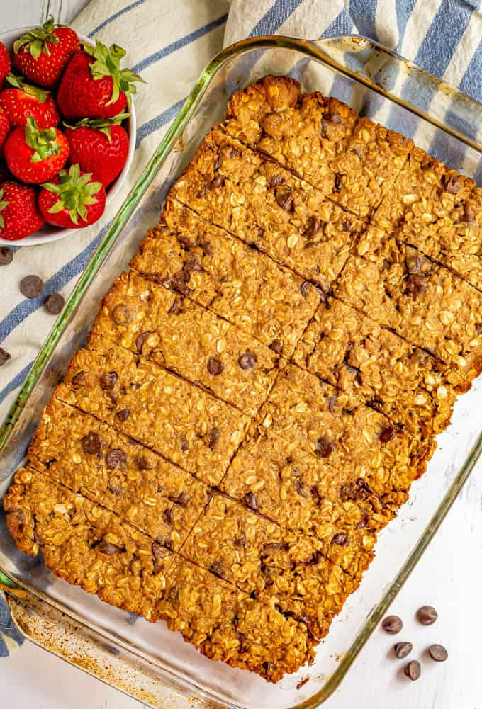 A batch of homemade granola bars after baking in the oven and with slices cut into bars