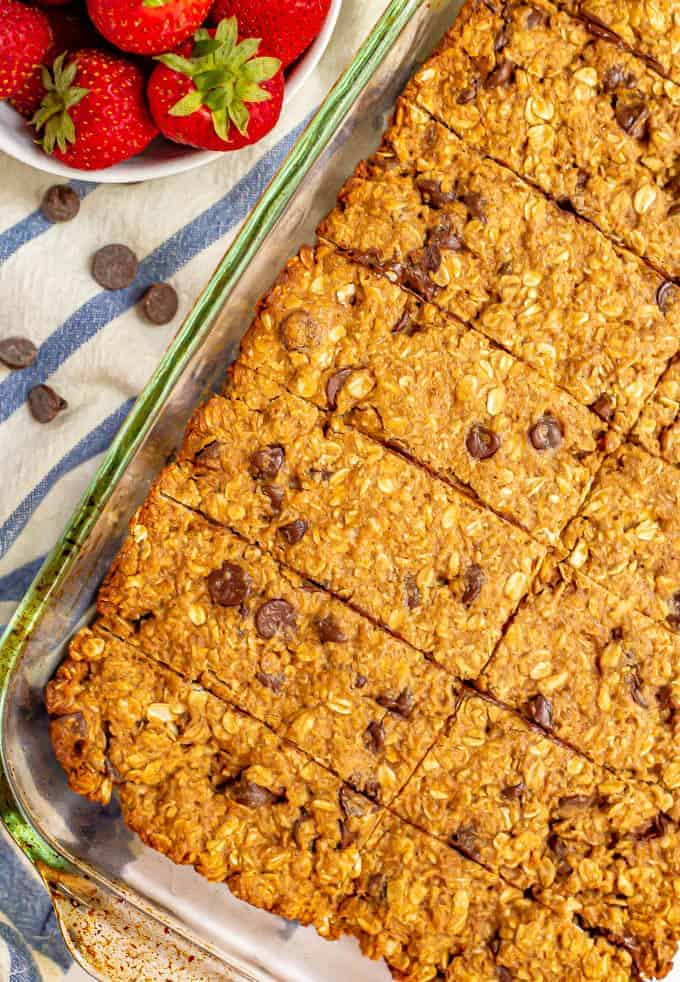 Baked homemade granola bars sliced in the glass pan