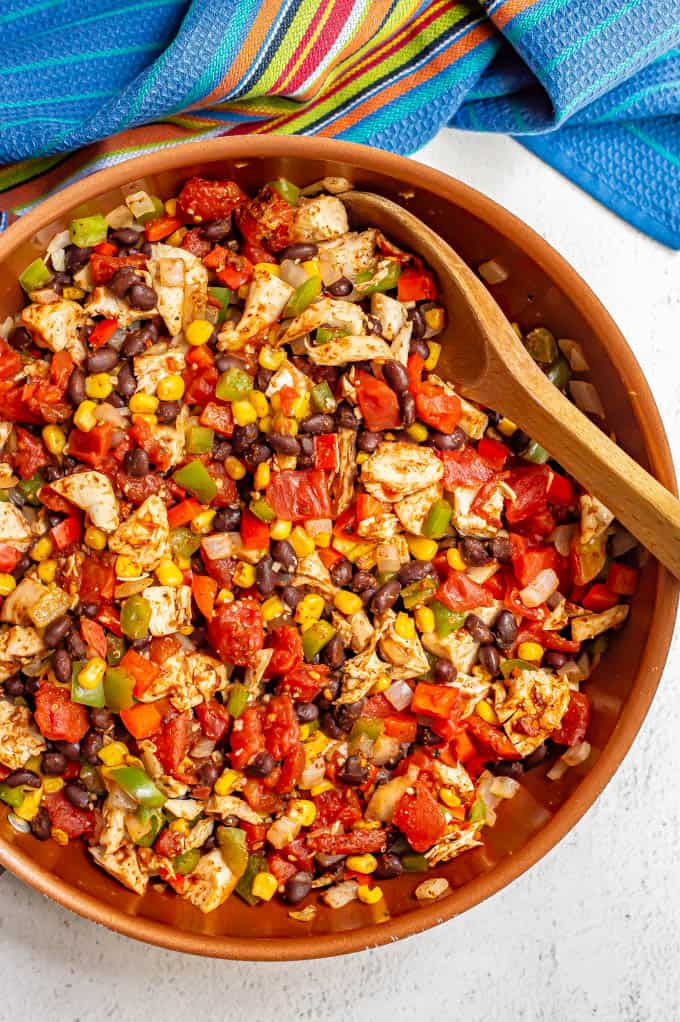 Skillet of southwestern chicken with black beans, tomatoes, corn and peppers