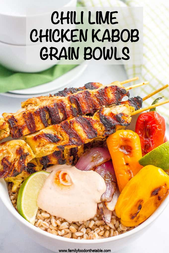 Chili lime chicken kabobs are grilled to perfection and served in a bowl with chewy farro, roasted peppers and onions, and topped with a creamy, smoky adobo sauce! #chickenkabobs #kabobs #summerrecipes