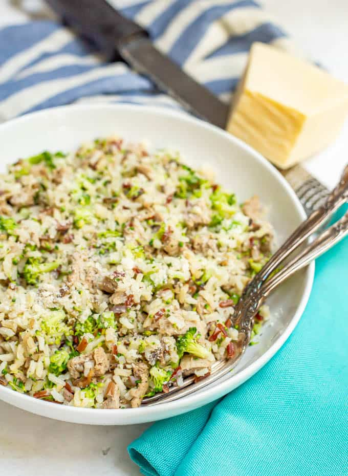 Serving of mixed rice with sausage and broccoli and Parmesan cheese