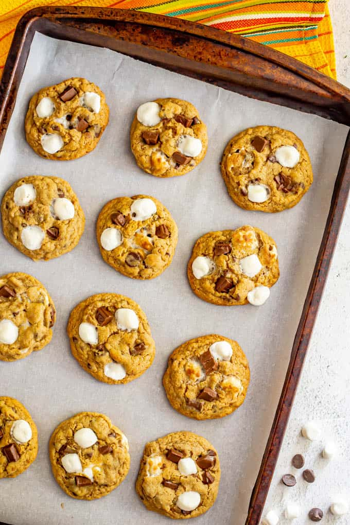 A baking sheet full of s'mores cookies warm from the oven