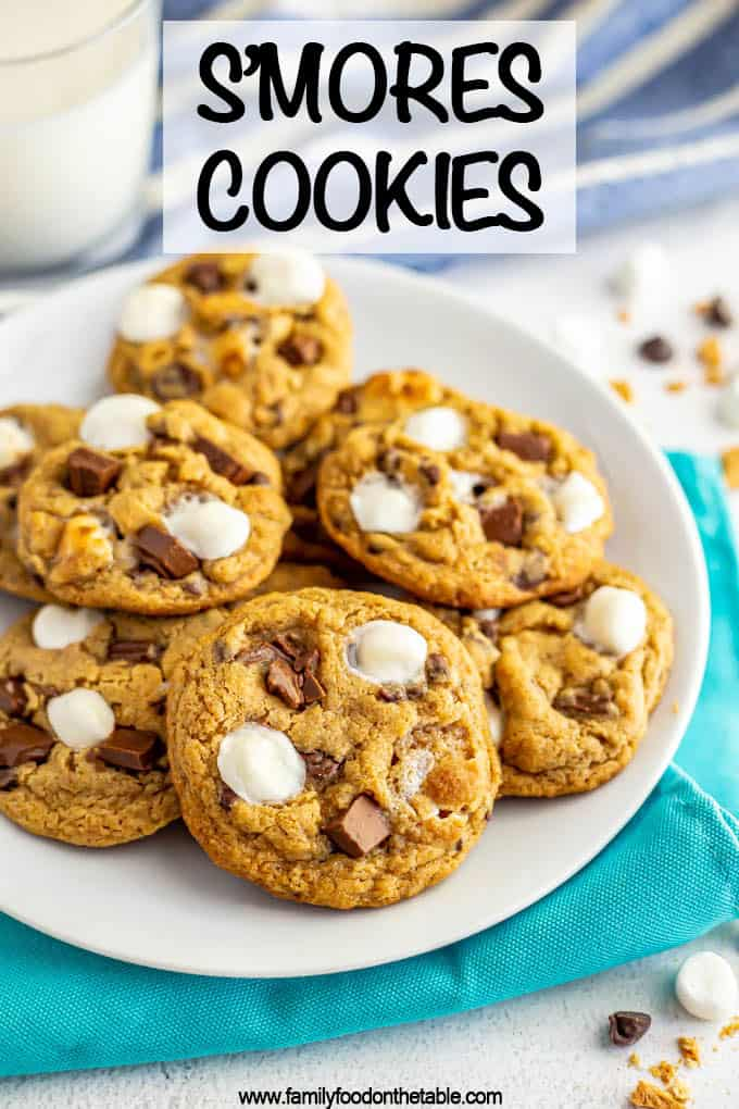 S'mores cookies are soft, gooey and completely irresistible! They've got graham cracker crumbs, mini marshmallows, chocolate chips and chopped chocolate bars for the ultimate summer treat! #smores #cookies #summerdessert #easydessert