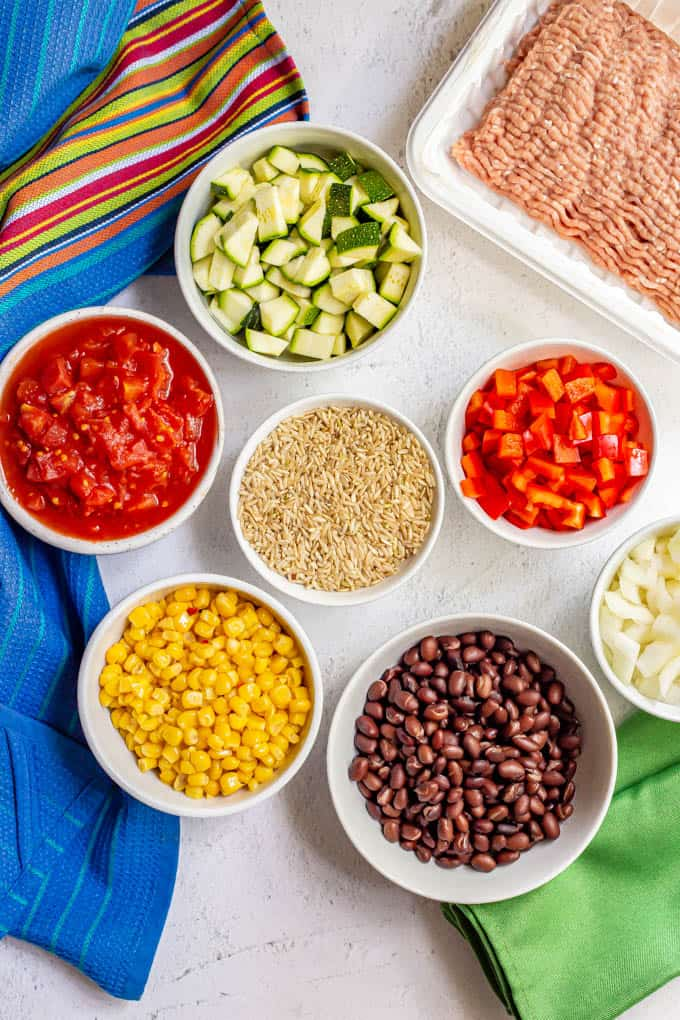 Ingredients laid out in separate bowls to make turkey taco rice skillet