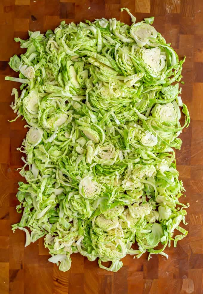Shredded Brussel sprouts piled on a cutting board