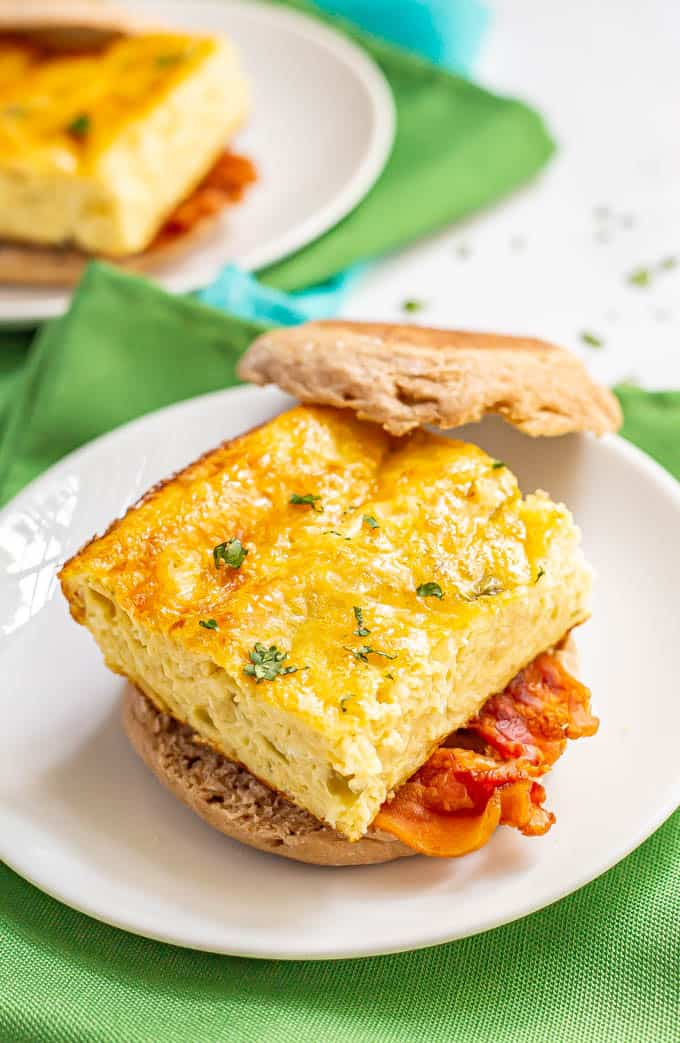 Cheesy egg breakfast sandwich with bacon