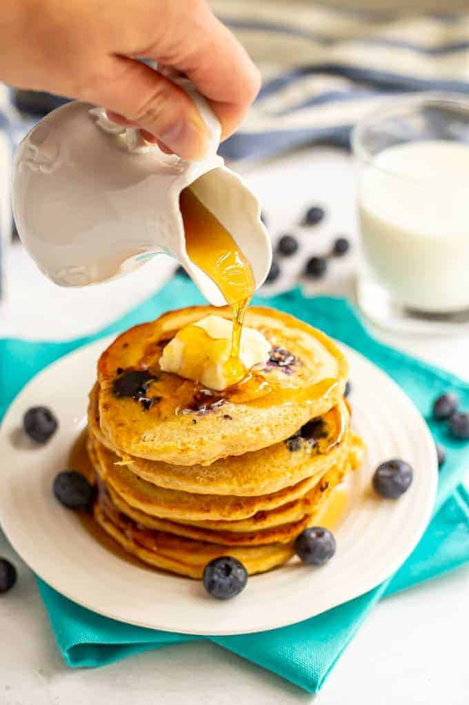 Healthy blueberry pancakes are light and fluffy and bursting with blueberries! These easy 1-bowl pancakes are the perfect way to start your day! #pancakes #blueberries #breakfast #healthyrecipes