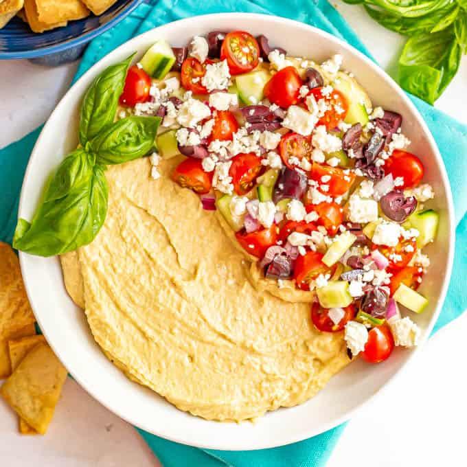 Hummus dip with Greek veggies and feta cheese on top
