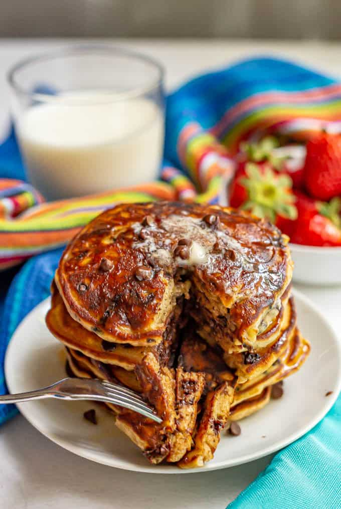Chocolate chip pancakes are light and fluffy and studded with melty chocolate chips! They require just 1 bowl and only take 10 minutes to mix up! #pancakes #chocolate #chocolateforbreakfast #breakfastideas #breakfastrecipes