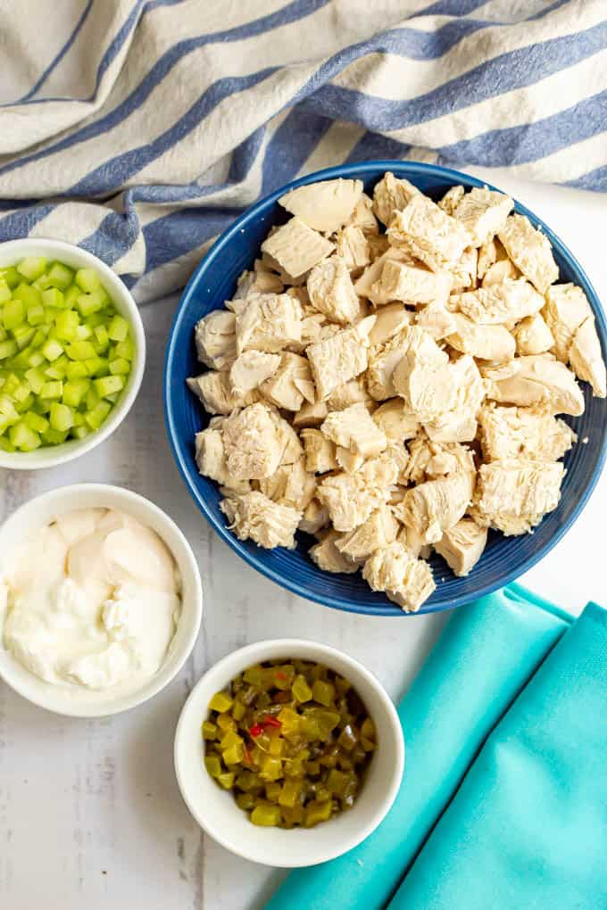 Ingredients for healthy chicken salad laid out in separate bowls