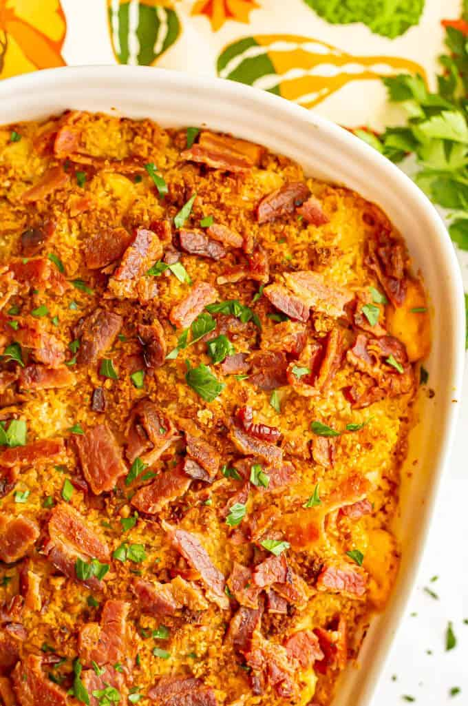 Pumpkin mac and cheese casserole with bacon and parsley on top after baking in the oven
