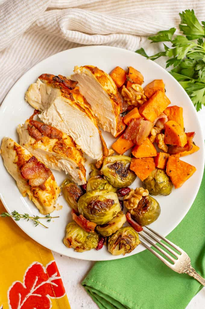 Dinner plate with roasted chicken, sweet potatoes and Brussels sprouts