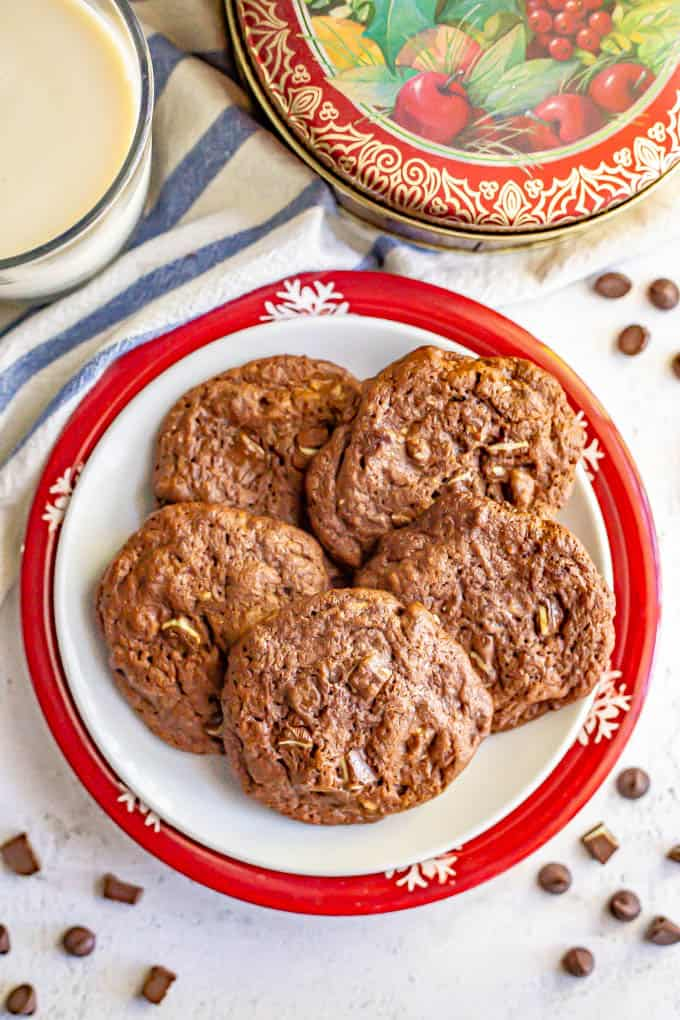 Holiday cookies arranged on a plate with chocolate chips sprinkled around