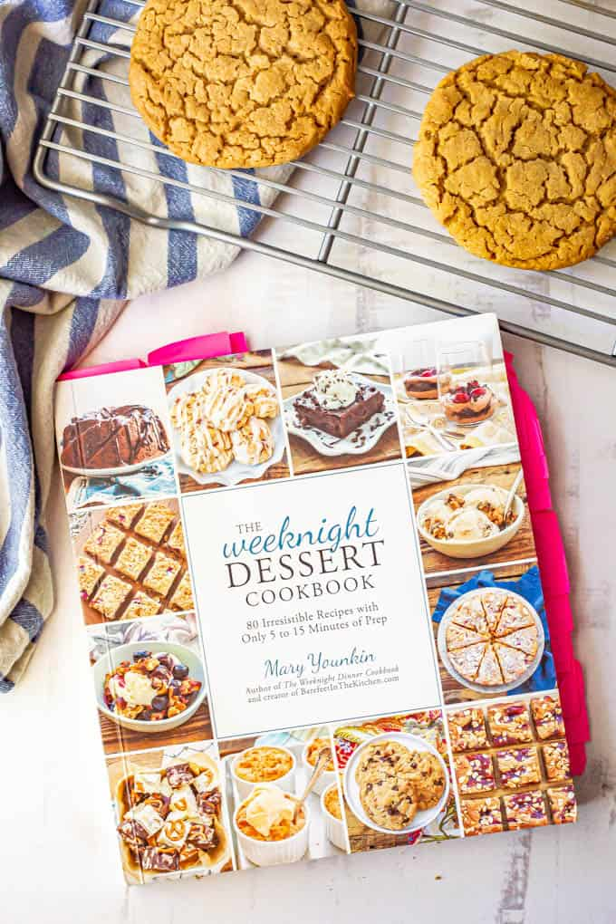 The Weeknight Dessert Cookbook beside a cooling rack with peanut butter cookies on it