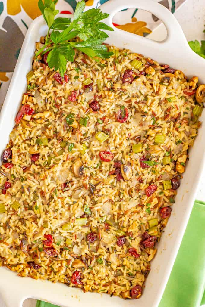 Wild rice dressing baked in a large white casserole dish